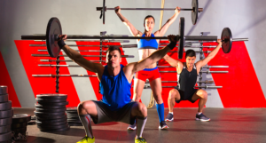 Athletic people doing gym routine for weight loss