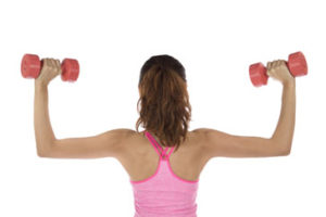 Young lady with dumbbells
