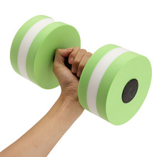 Extreme weight loss workout. A light green dumbbell with a white stripe